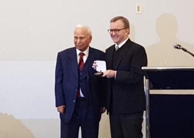 Senator G. Mitchel  presenting V.P.  Iqbal Bokhari ,  Canada 150 Senate award.